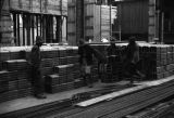 Shanghai (China), workers carrying construction materials