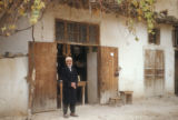 Syria, man standing near doorway