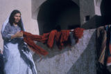 Esfahan province (Iran), woman draping yarn over wall