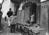 China, child vendor next to the carpenter's temple