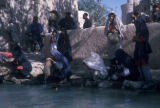 Esfahan province (Iran), women collecting water from river