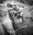 Chanthaburi Changwat (Thailand), man cutting Laterite blocks