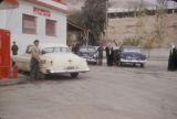 Syria, men and cars at a gas station