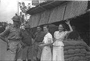 Shanghai (China), women and military personnel in front of sandbag bunker