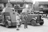 Shanghai (China), men standing in front of armored cars