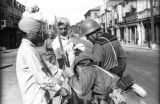 Shanghai (China), soldiers inspecting items belonging to two Sikh men