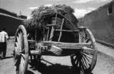 China, wagon loaded with hay and boulders