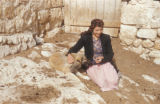 Malula (Syria), woman feeding a dog