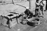 China, man using water from well