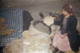 Malula (Syria), woman kneading dough for flatbread