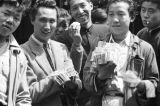 Shanghai (China), men hawking paper currency