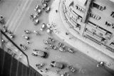 Shanghai (China), aerial view of rickshaws and automobiles on street