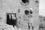 China, Harrison Forman and Japanese soldier standing in front of bombed blockhouse