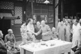 China, Harrison Forman shaking hands with an unidentified Japanese official