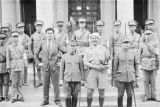 China, Harrison Forman with Japanese military personnel and other men