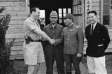 China, Harrison Forman with unidentified Japanese officer and other men