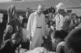Xuzhou (China), Harrison Forman and Rev. Francis Brown watching women make food