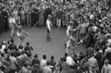 Chongqing (China), crowd watching men demonstrate fighting with wood weapons