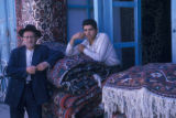 Esfahan province (Iran), two men standing in door of rug shop