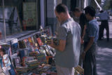 Tehran (Iran), customers at open-air book stall
