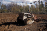 Syria, tractor plowing a field