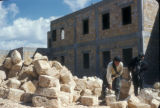 Syria, pile of cement blocks near a newly constructed building