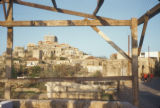Malula (Syria), city on a hillside seen through a building frame