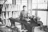 Guiyang (China), man operating lathe to manufacture artificial limbs
