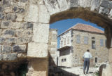 Syria, looking through an archway at city buildings