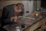 Damascus (Syria), craftsman drawing a design onto metal