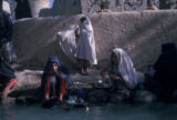 Esfahan province (Iran), girls cleaning dishes in river