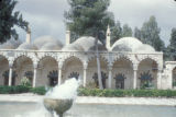 Syria, fountain and pool in front of a mosque