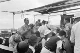 Shanghai (China), Harrison Forman filming evacuees on deck of ship