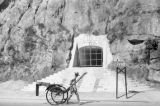 Hong Kong (China), man with rickshaw passing air raid tunnel on Gascoigne Road
