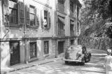 Hong Kong (China), car driving in front of Matsubara Hotel fortified with barbed wire