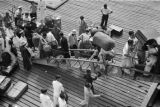 Hong Kong (China), people carrying luggage and boarding boat