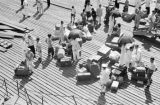 Hong Kong (China), aerial view of people waiting on pier with luggage and umbrellas