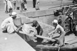 Hong Kong (China), people using gangplank to load cargo onto sampan