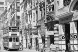 Hong Kong (China), commercial street with tram and shop signs