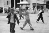Hong Kong (China), men carrying sedan chair across street