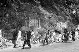 Hong Kong (China), people walking past air raid shelters