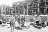 Hong Kong (China), street vendors selling produce in front of air raid shelters