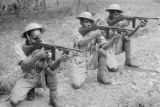 Malaysia, Gurkha troopers aiming firearms during Malayan Emergency