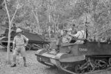 Malaysia, Royal Artillery troops riding tank through jungle