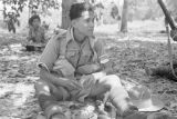 Malaysia, soldier resting in jungle during the Malayan Emergency