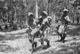 Malaysia, soldiers carrying injured soldier during the Malayan Emergency