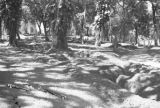 Indochina, view of park with air raid shelters dug in ground