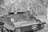 Malaysia, soldiers riding in tank through jungle during Malayan Emergency