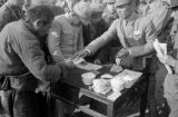 Changde (China), soldier giving relief money to refugee of Battle of Changde