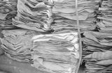 Singapore, close-up of bundled sheets of rubber for delivery
